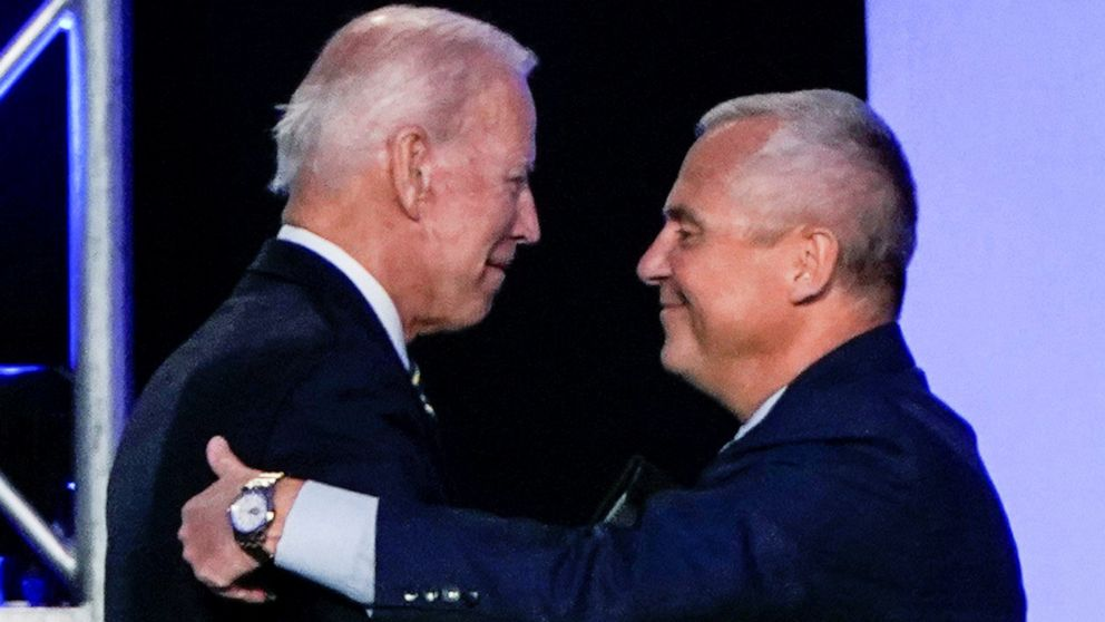 Former Vice President Joe Biden hugs International Brotherhood of Electrical Workers President Lonnie Stephenson before he addresses the IBEW construction and maintenance conference in Washington, April 5, 2019.