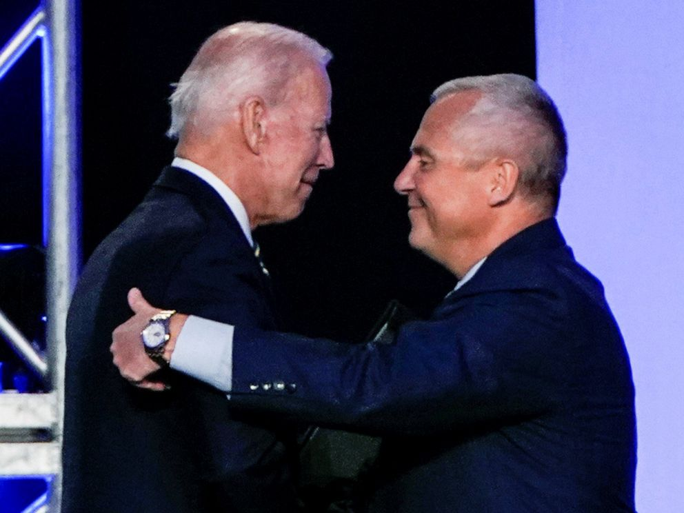 PHOTO: Former Vice President Joe Biden hugs International Brotherhood of Electrical Workers President Lonnie Stephenson before he addresses the IBEW construction and maintenance conference in Washington, April 5, 2019.
