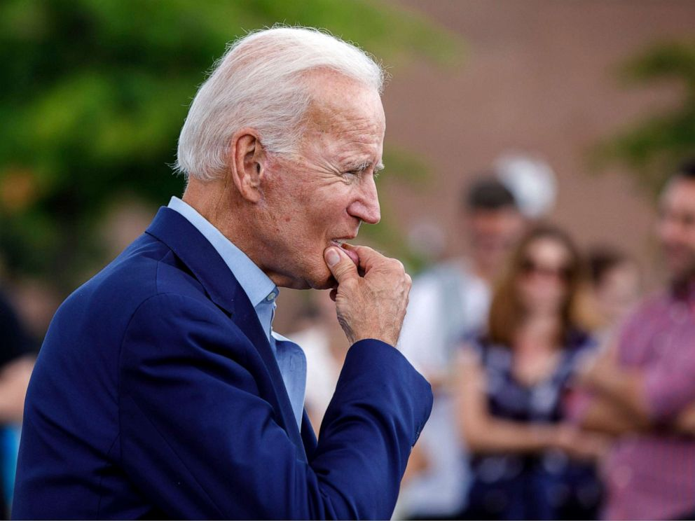 PHOTO: Democratic presidential candidate and former Vice President Joe Biden approaches reporters to answer questions following a campaign stop at Lindys Diner in Keene, N.H., Aug. 24, 2019.