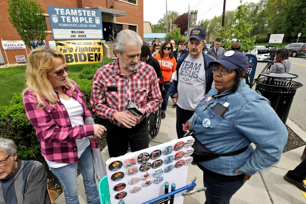 PHOTO: A woman sells buttons outside the Teamster Hall Local 249 before a rally by former Vice President and Democratic presidential candidate Joe Biden at the Teamster Hall Local 249 in Pittsburgh, April 29, 2019.