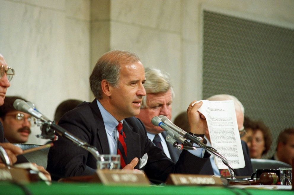 PHOTO: Senate Judiciary Committee Chairman Joseph Biden holds up a copy of the FBI report on Anita Hill during committee hearings on Capital Hill about her allegations against Judge Clarence Thomas.