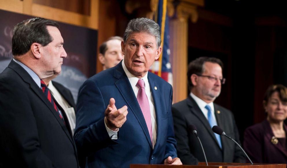 Sen. Joe Manchin participates in the Senate Democrats news conference on tax reform in the Capitol, Nov. 28, 2017.