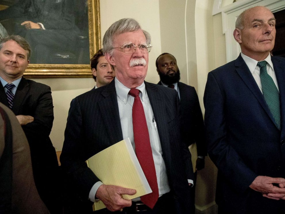 PHOTO: National security adviser John Bolton, center, and President Donald Trumps chief of staff John Kelly, right, attend a meeting with President Donald Trump and members of Congress in the Cabinet Room of the White House, July 17, 2018, in Washington.