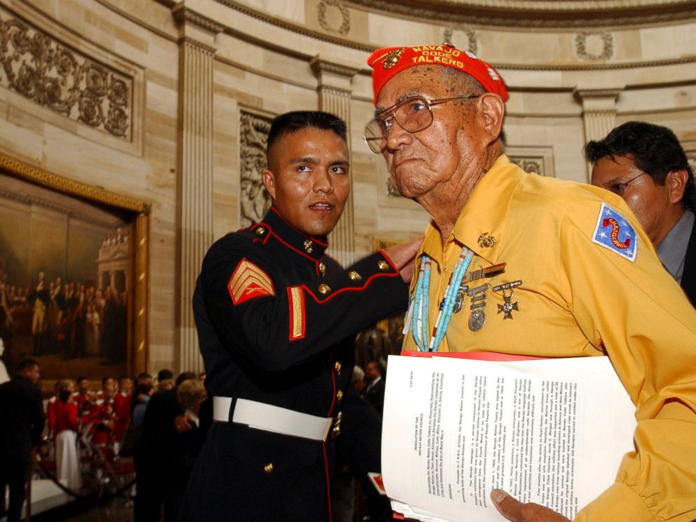 PHOTO: John Brown, Jr., Navajo Code Talker, gets a pat on the back from a young Marine after he received the Congressional Gold Medal at the Capitol in Washington, D.C.
