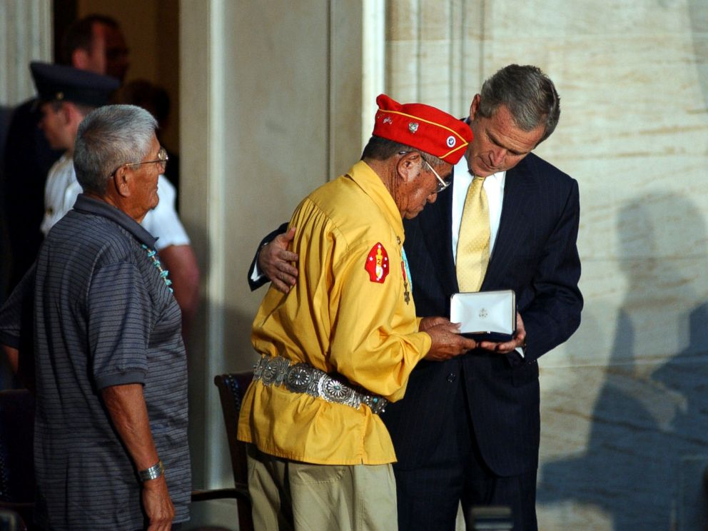 PHOTO: President George W. Bush presents the Gold Medal to John Brown, Jr., Navajo Code Talker, during the Gold Medal Ceremony at the Capitol in Washington, D.C.