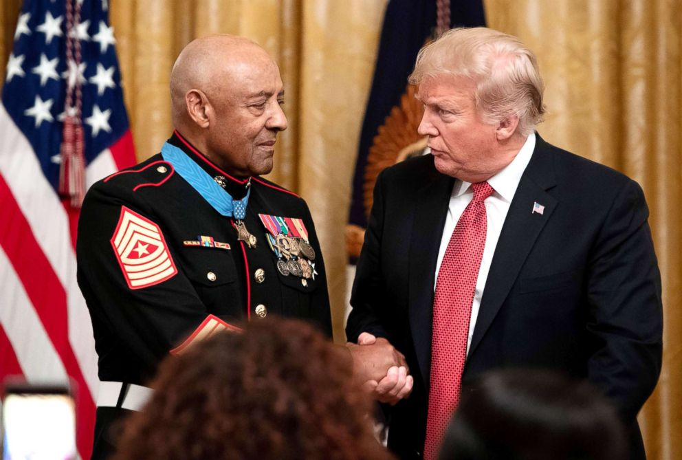 PHOTO: President Donald Trump shakes hands with Retired U.S. Marine Sergeant Major John L. Canley, after awarding him the Medal of Honor for actions during the Vietnam War, at a ceremony in the East Room of the White House, Oct. 17, 2018.