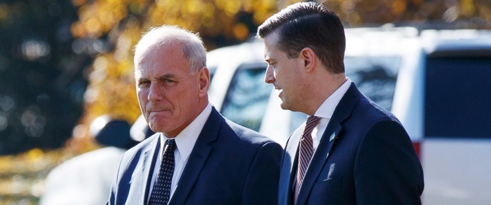 PHOTO: White House Chief of Staff John Kelly walks with White House staff secretary Rob Porter to board Marine One on the South Lawn of the White House in Washington, Nov. 29, 2017.