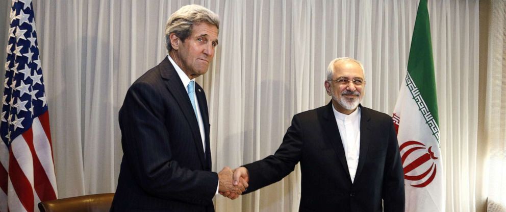 PHOTO: Iranian Foreign Minister Mohammad Javad Zarif shakes hands with then-U.S. Secretary of State John Kerry in Geneva, Jan. 14, 2015.