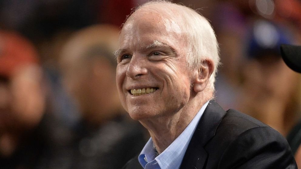 Sen. John McCain smiles while attending a baseball game between the Los Angeles Dodgers and Arizona Diamondbacks at Chase Field on Aug. 10, 2017 in Phoenix.