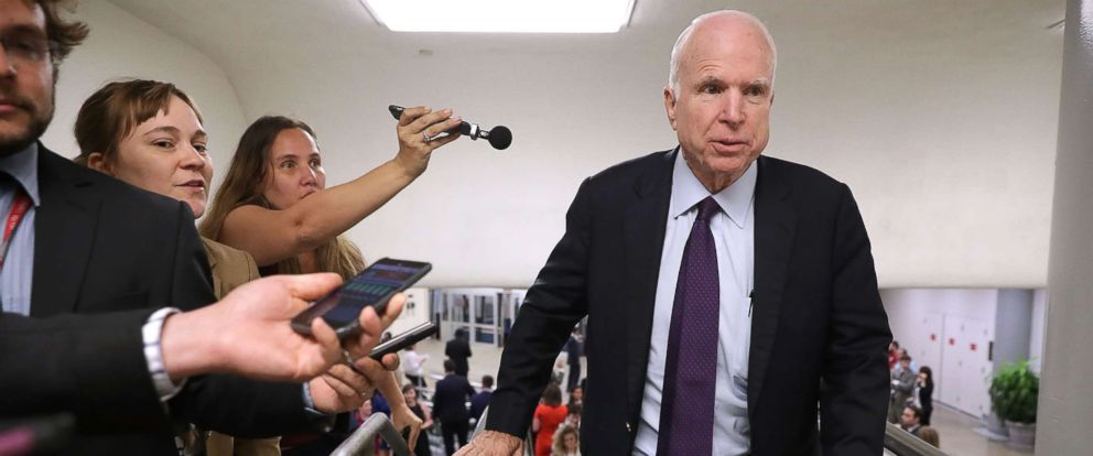 PHOTO: Sen. John McCain is pursued by reporters as he heads for a vote at the U.S. Capitol, September 6, 2016, in Washington, DC.