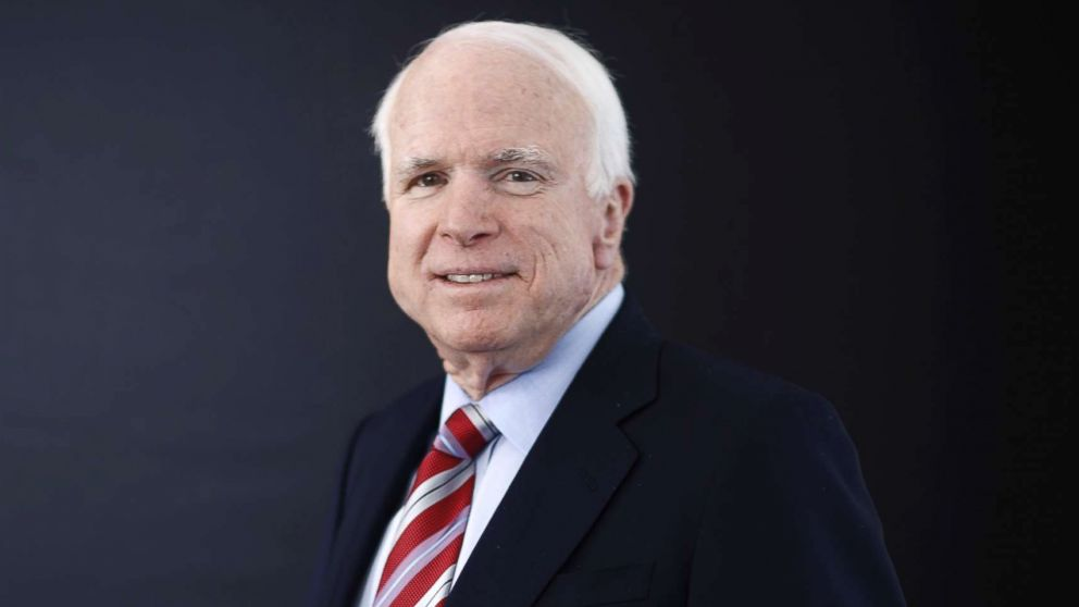 Sen. John McCain poses for a photograph at the World Economic Forum (WEF) in Davos, Switzerland, Jan. 23, 2014.