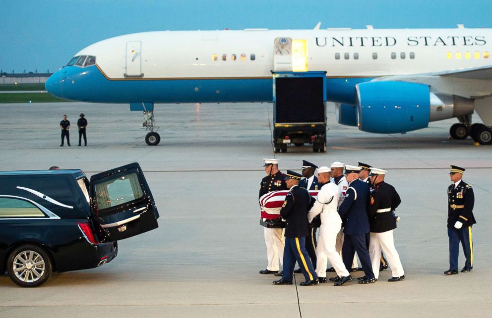 PHOTO: Members of the military carry the flag-draped casket of the late U.S. Senator John McCain, after arriving on a military airplane at Joint Base Andrews in Md., Aug. 30, 2018.
