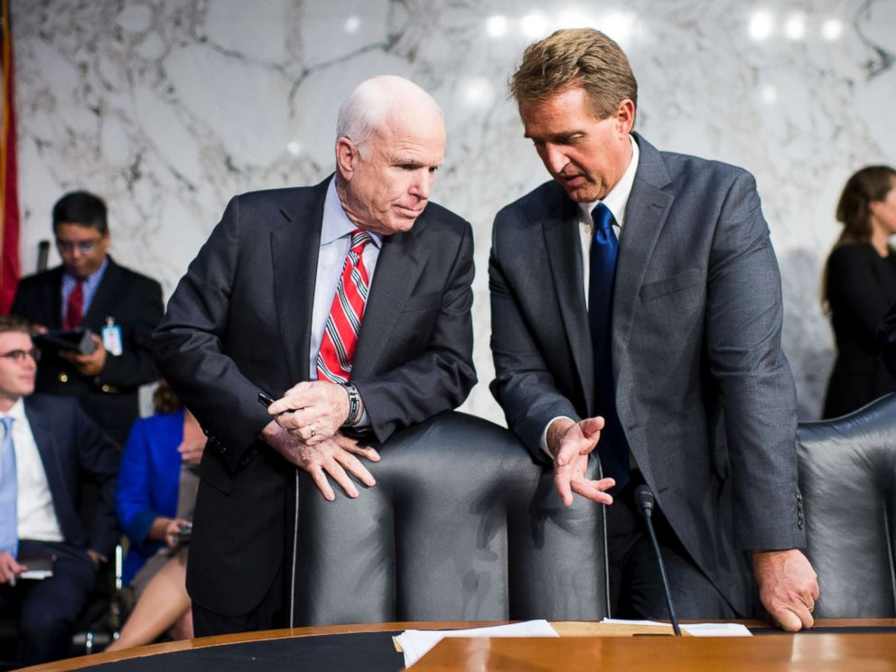 PHOTO: Sen. John McCain, left, and Sen. Jeff Flake, talk before the start of the Senate Foreign Relations hearing to debate the authorization for use of military force in Syria, Sept. 3, 2013.