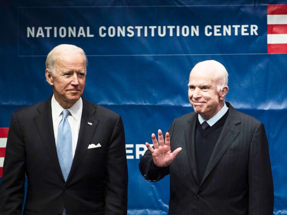 PHOTO: Sen. John McCain, right, accompanied by Chair of the National Constitution Centers Board of Trustees, former Vice President Joe Biden, waves as he takes the stage before receiving the Liberty Medal in Philadelphia, Oct. 16, 2017.