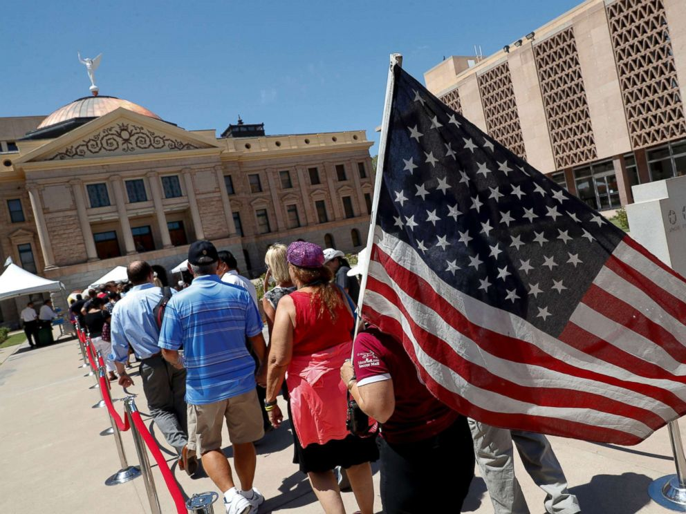 PHOTO: Members of the public line up to pay their respects for Sen. John McCain during a viewing at the Arizona Capitol, Aug. 29, 2018, in Phoenix.