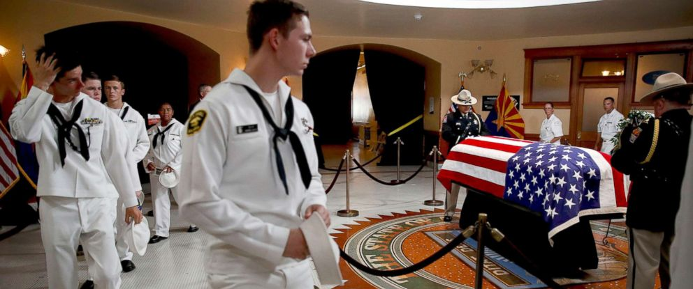 PHOTO: U.S. Naval sea cadets walk past the casket to pay their respects to Sen. John McCain at the Arizona Capitol, Aug. 29, 2018, in Phoenix.