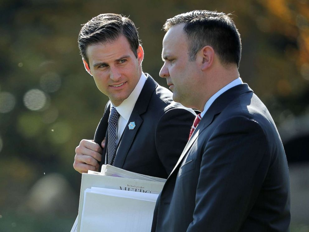 PHOTO: John McEntee and White House Director of Social Media Dan Scavino leave the White House with President Donald Trump Nov. 29, 2017 in Washington.