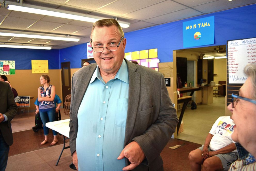 U.S. Sen. Jon Tester speaks with a supporter during an event at the Tester campaign headquarters in Billings, Mont., June 8, 2018.