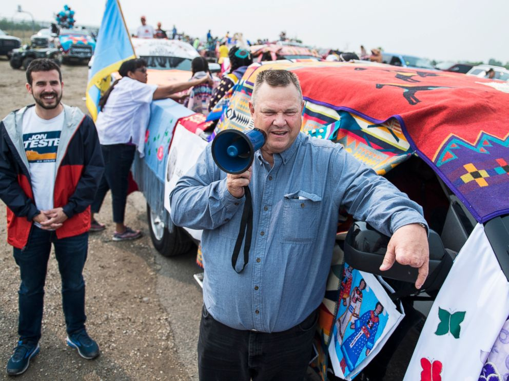 PHOTO: Sen. Jon Tester addresses constituents before a parade at Crow Fair in Crow Agency, Mont., Aug. 19, 2018.