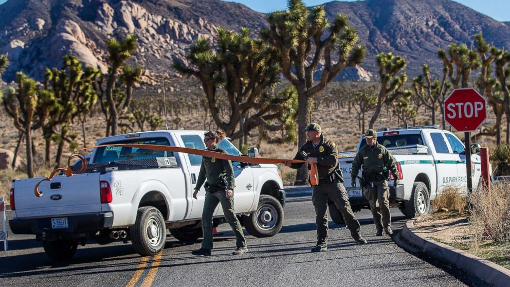 Park rangers close off the access road to a campground at Joshua Tree National Park on Jan. 2, 2019, in Joshua Tree, Calif.