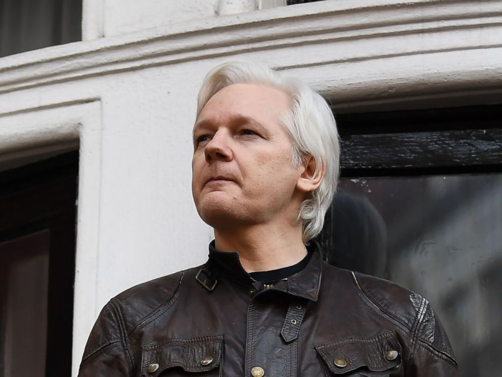 PHOTO: Wikileaks founder Julian Assange speaks to the media from the balcony of the Embassy of Ecuador in London on May 19, 2017.