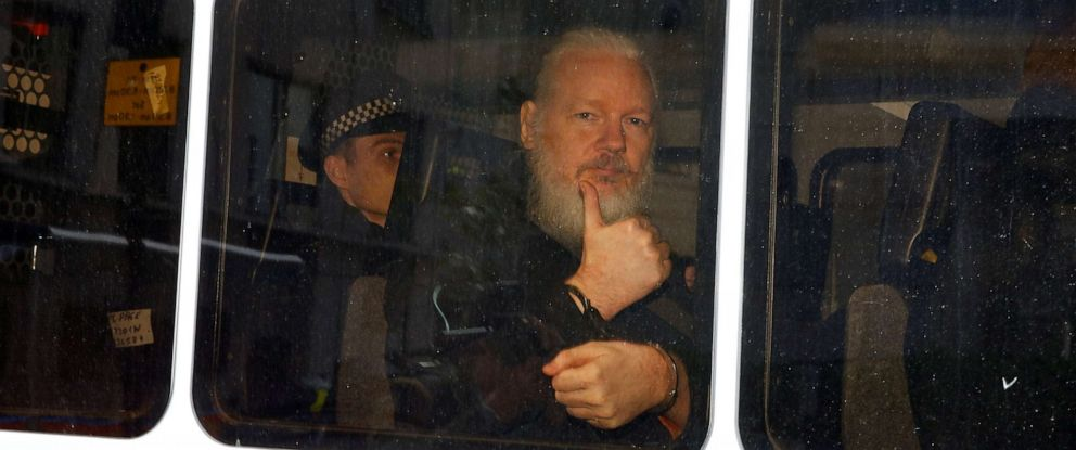 PHOTO: WikiLeaks founder Julian Assange is seen in a police van after was arrested by British police outside the Ecuadorian embassy in London, April 11, 2019.