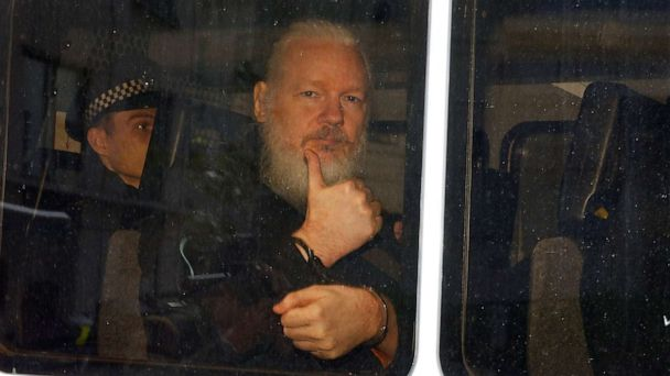 President of Ecuador accuses Julian Assange of using embassy as a 'center for spying' as new footage emerges of his life inside