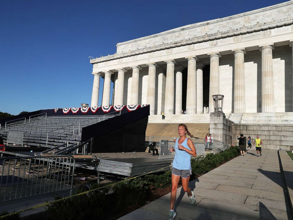 PHOTO: A jogger runs past the Lincoln Memorial ahead of the July 4th Salute to America celebration, July 2, 2019, in Washington, D.C.