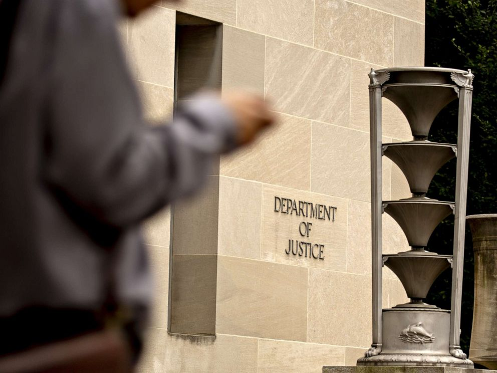 PHOTO: A pedestrians walks past the U.S. Department of Justice (DOJ) headquarters in Washington, D.C., Aug. 15, 2019.