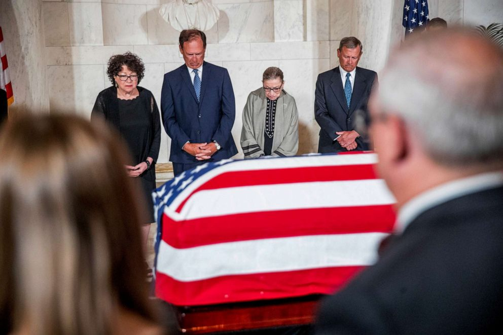 PHOTO: A moment of silence during a private ceremony in the Great Hall of the Supreme Court in Washington, July 22, 2019, where the late Supreme Court Justice John Paul Stevens lies in repose.
