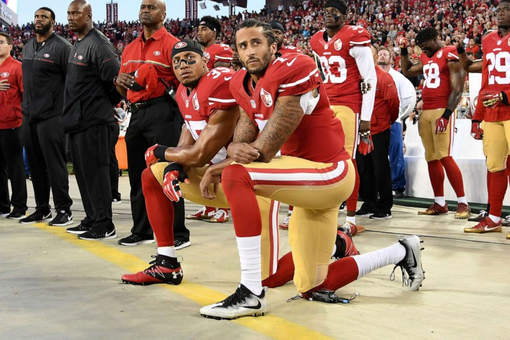 PHOTO: Colin Kaepernick #7 and Eric Reid #35 of the San Francisco 49ers kneel in protest during the national anthem prior to playing the Los Angeles Rams in their NFL game at Levis Stadium on September 12, 2016 in Santa Clara, California.