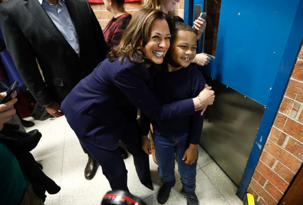 Sen. Kamala Harris, D-Calif., hugs eight-year-old Manaath Kai, of Des Moines, Iowa, after a get out the vote rally, Oct. 22, 2018, at Des Moines Area Community College in Ankeny, Iowa.
