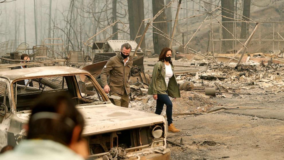 PHOTO: California Gov. Gavin Newsom and Democratic vice presidential candidate Sen. Kamala Harris, asses the damage during the Creek Fire at Pine Ridge Elementary,  in Auberry, Calif., Sept. 15, 2020.