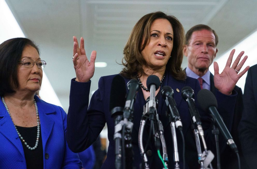 Democratic Sen. Kamala Harris, joined from left by, Sen. Mazie Hirono, D-Hawaii, and Sen. Richard Blumenthal, D-Conn., speaks to media about the Judiciary Committee hearing on Supreme Court nominee Judge Brett Kavanaugh in Washington, Sept. 28, 2018.