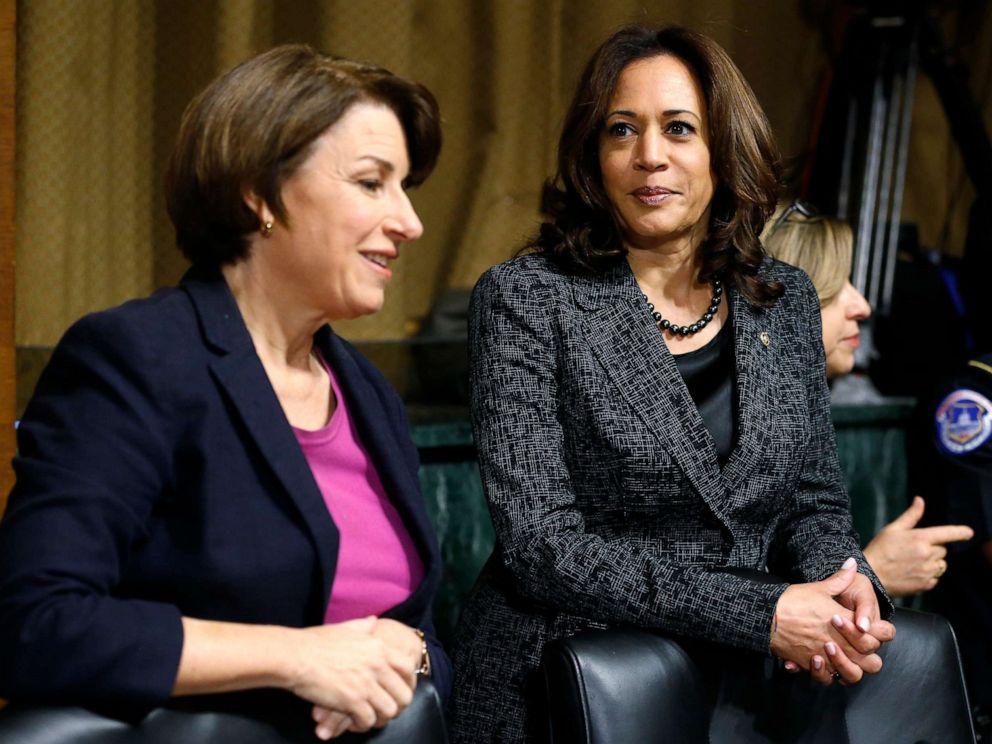 PHOTO: Senators Amy Klobuchar, D-Minn. and Kamala Harris, D-Calif., talk before the Senate Judiciary Committee hearing with Christine Blasey Ford, Sept. 27, 2018, on Capitol Hill.