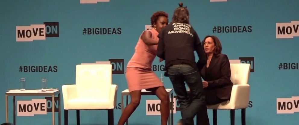 PHOTO: Sen. Kamala Harris, right, was rushed on stage at a MoveOn event in San Francisco by an animal rights activist Saturday, June 1, 2019.