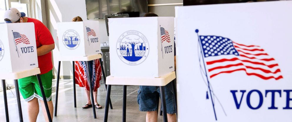 PHOTO: Voters cast their ballots on primary day in Kansas City, Kan., Aug. 7, 2018.