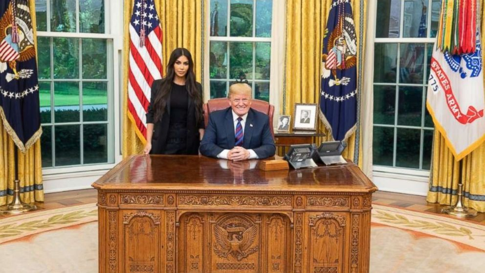 Kim Kardashian West poses with Donald Trump during their meeting in the Oval Office at the White House on Wednesday, May 30, 2018.