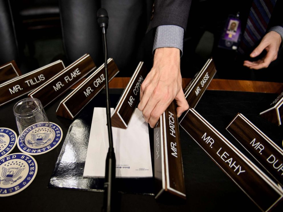 PHOTO: A staff member places name plates as the Senate Judiciary Committees room on Capitol Hill, Sept. 26, 2018 in Washington, during preparations one day before the hearing with Blasey Ford and Supreme Court nominee Judge Brett Kavanaugh.