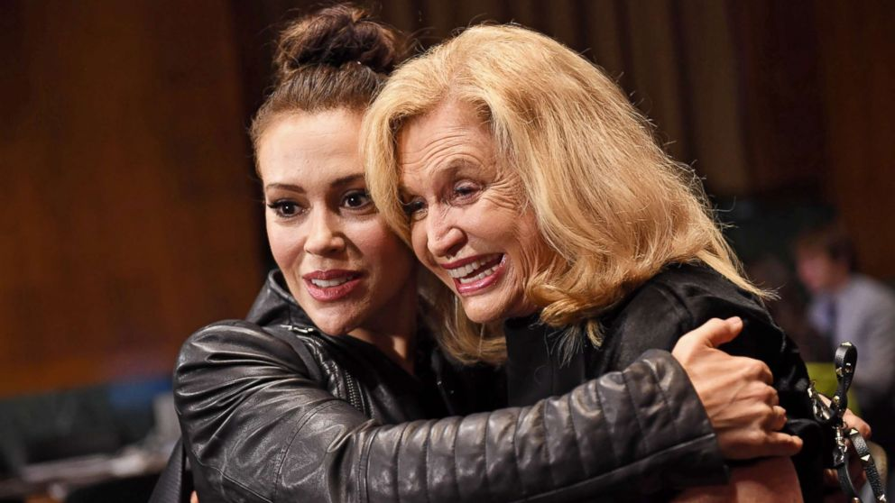 Actress Alyssa Milano hugs Rep. Carolyn Maloney in the hearing room prior to the Senate Judiciary Committee hearing on the nomination of Brett Kavanaugh on Capitol Hill in Washington, Sept. 27, 2018.