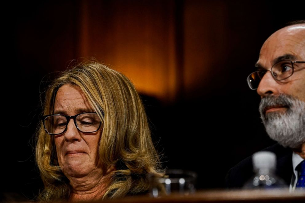 PHOTO: Christine Blasey Ford, sitting next to one of her lawyers, Michael R. Bromwich, tears up during a Senate Judiciary Committee hearing on Capitol Hill, Sept. 27, 2018 in Washington.