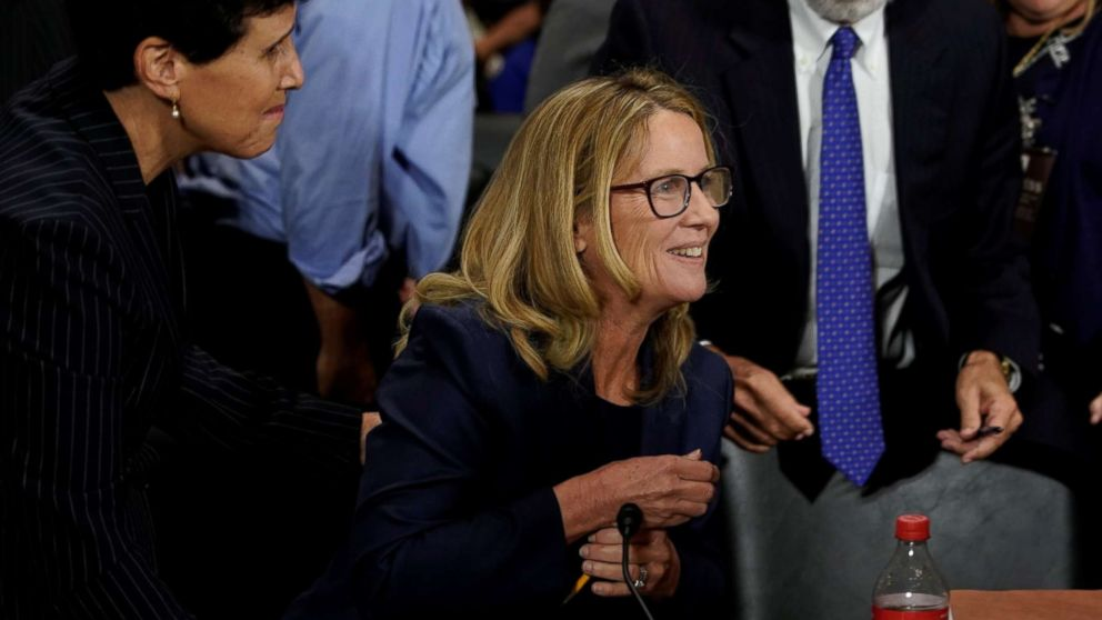 Christine Blasey Ford reacts near her attorney Debra Katz after she finished testifying before the Senate Judiciary Committee on Capitol Hill in Washington, Sept. 27, 2018.