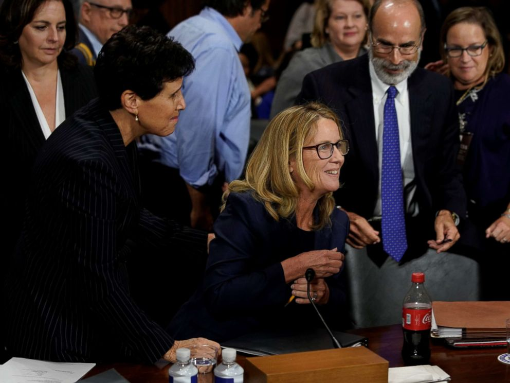 PHOTO: Christine Blasey Ford reacts near her attorney Debra Katz after she finished testifying before the Senate Judiciary Committee on Capitol Hill in Washington, Sept. 27, 2018.