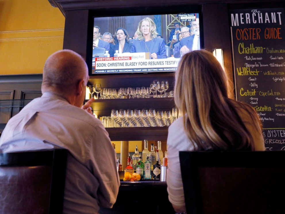 PHOTO: Diners watch the televised testimony by Christine Blasey Ford in the confirmation hearings for Supreme Court nominee Brett Kavanaugh by the Senate Judiciary Committee, at a restaurant in Boston, Sept. 27, 2018.