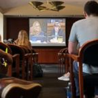 Students of the George Washington University Law School gather at Lisner Hall to watch the Senate Supreme Court confirmation hearing into sexual assault allegations from Christine Blasey Ford against Supreme Court nominee Judge Brett M. Kavanaugh in Washington, Sept. 27, 2018.