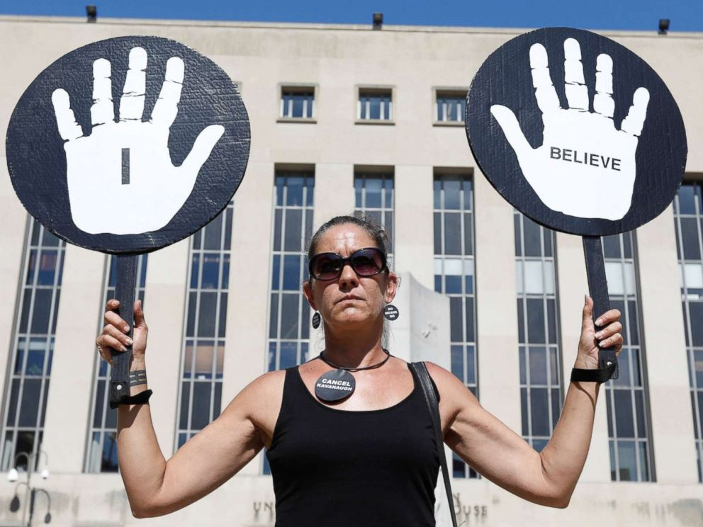 PHOTO: An woman expresses support for Christine Blasey Ford, the university professor who has accused U.S. Supreme Court nominee Brett Kavanaugh of sexual assault in 1982voutside U.S. District Court in Washington, Oct. 4, 2018.