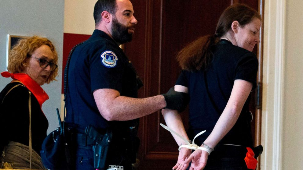 Protesters against Supreme Court nominee Brett Kavanaugh are arrested after blocking the office of Sen. Jeff Flakes, Republican of Arizona, in Washington on Oct. 5, 2018. With a 51-49 vote the U.S. Senate moved to a final vote on President Donald Trump's embattled Supreme Court pick amid continuing controversy over sexual abuse allegations against him.