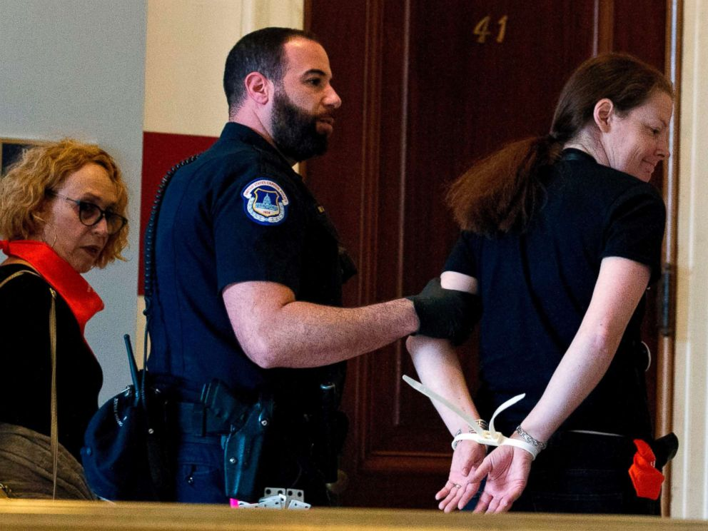 PHOTO: Protesters against Supreme Court nominee Brett Kavanaugh are arrested after blocking the office of Sen. Jeff Flakes, Republican of Arizona, in Washington on Oct. 5, 2018.