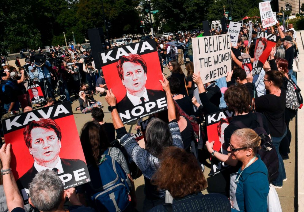 PHOTO: Demonstrators protesting Judge Brett Kavanaughs nomination to the Supreme Court hold signs in front of the Supreme Court in Washington after allegations of sexual assault, Sept. 28, 2018.