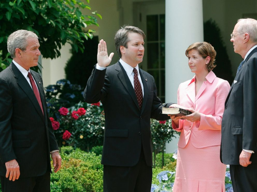 In this June 1, 2006 file photo, from left to right, President Bush, watches the swearing-in of Brett Kavanaugh as Judge for the U.S. Court of Appeals for the District of Columbia by U.S.